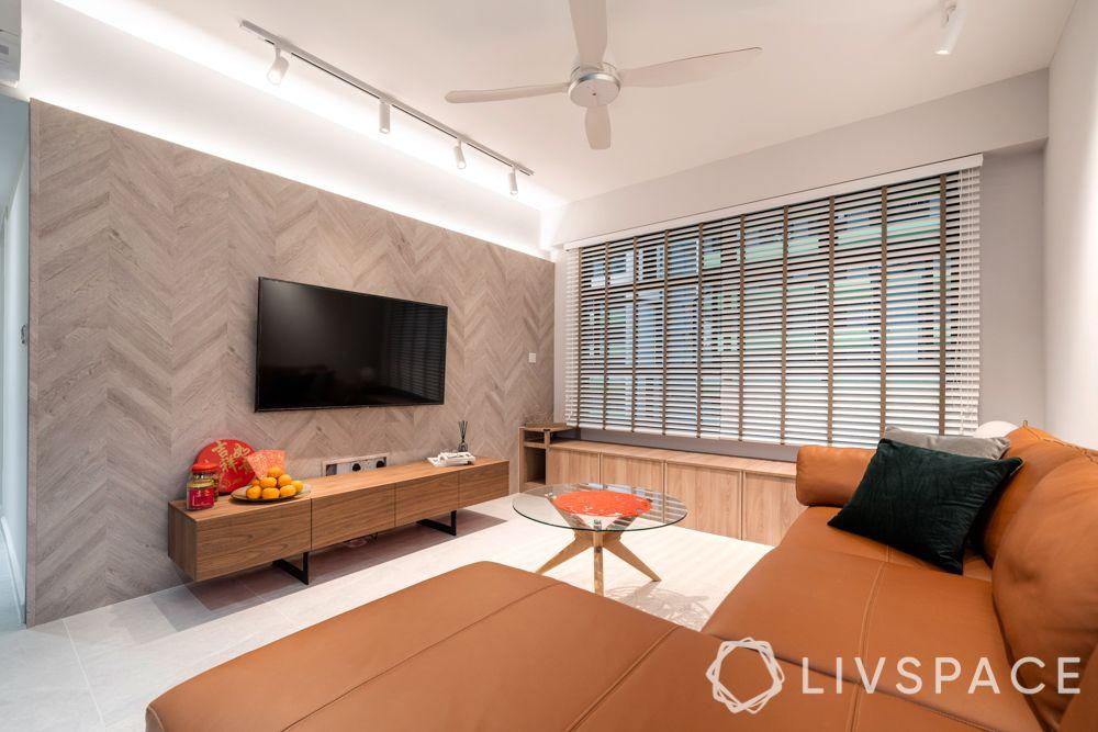 wabi-sabi-style-living-room-l-shaped-tan-sofa-vinyl-wall-tiles