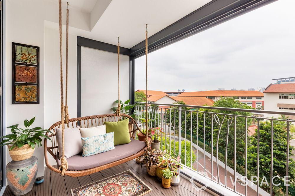 balcony-swing-greenery-plants-wooden-deck