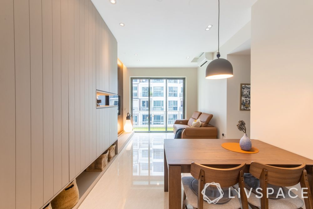 condo-renovations-foyer-wooden-dining-table-big-storage-unit