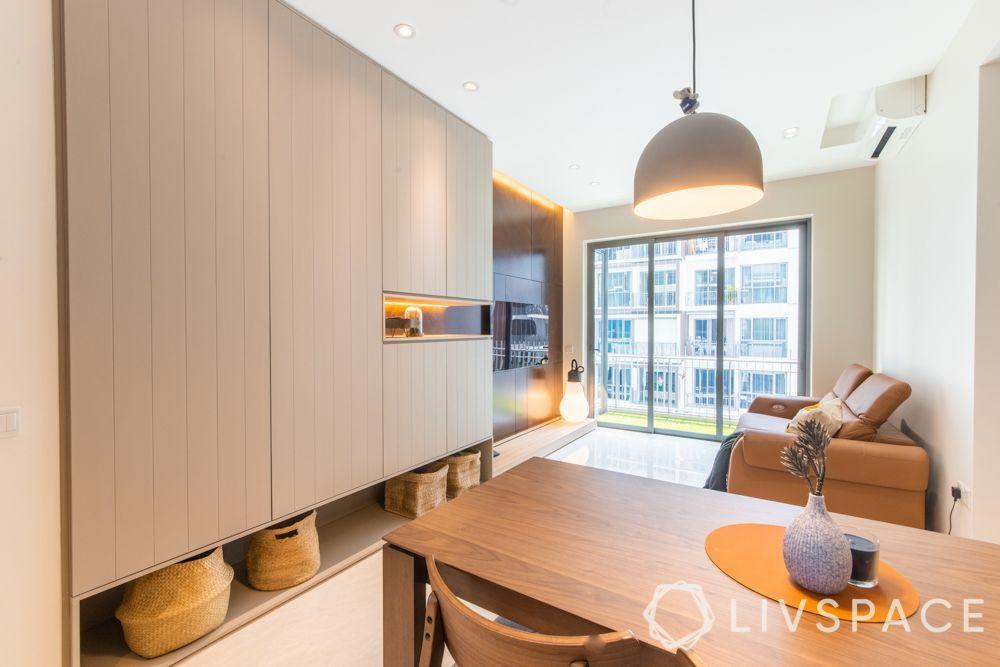 condo-renovations-beige-laminate-storage-unit-pendant-light