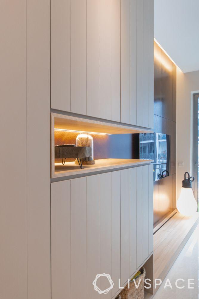 condo-renovations-storage-unit-niche-shelf-under-cabinet-lighting