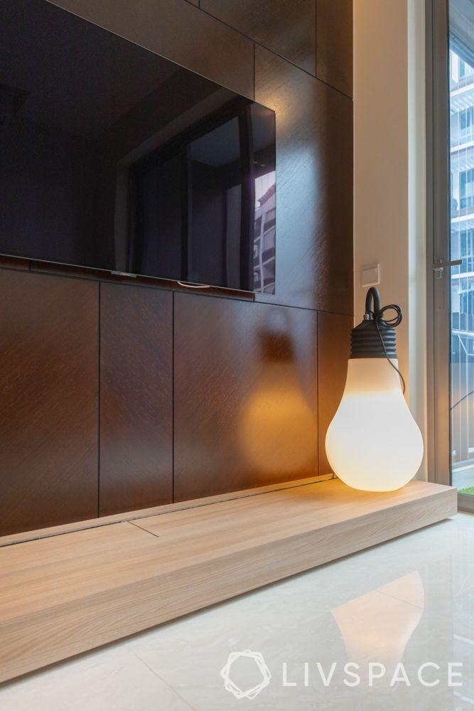 condo-renovations-wooden-tv-unit-decorative-light