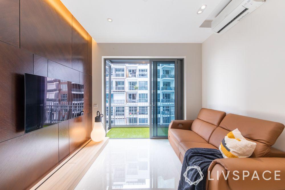 condo-renovations-living-room-recliner-sofa-glossy-flooring