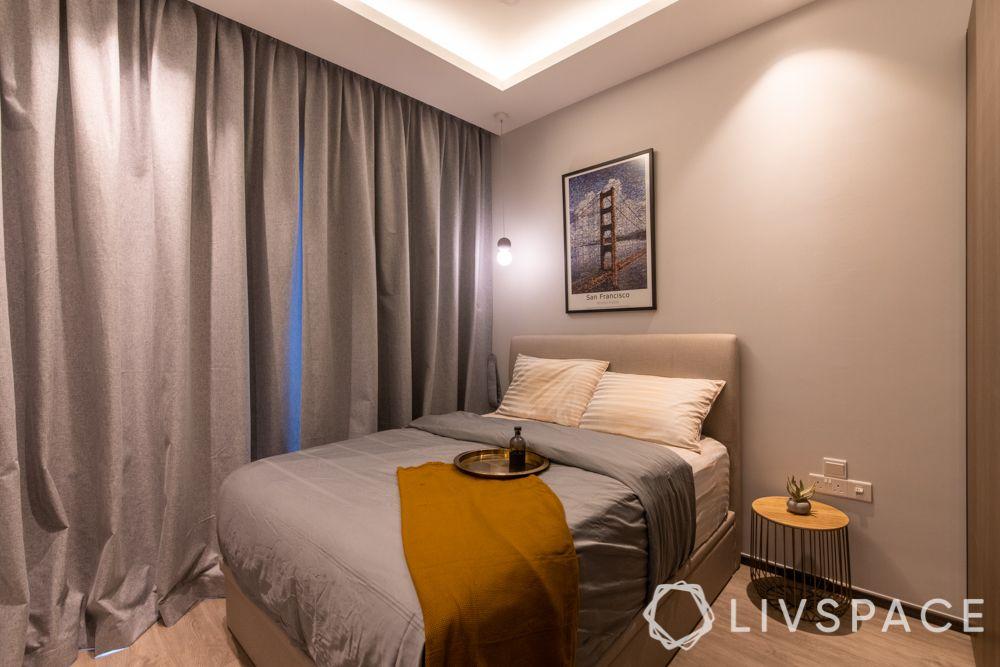 condo-renovations-master-bedroom-beige-upholstered-bed