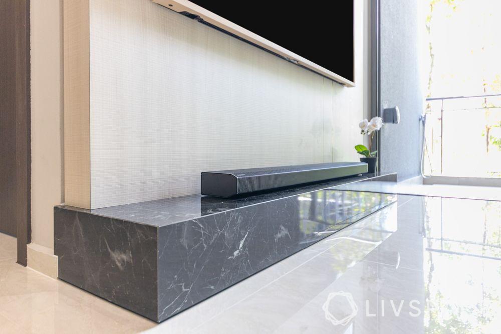 small-condo-renovation-ideas-living-room-TV-unit-marble-ledge