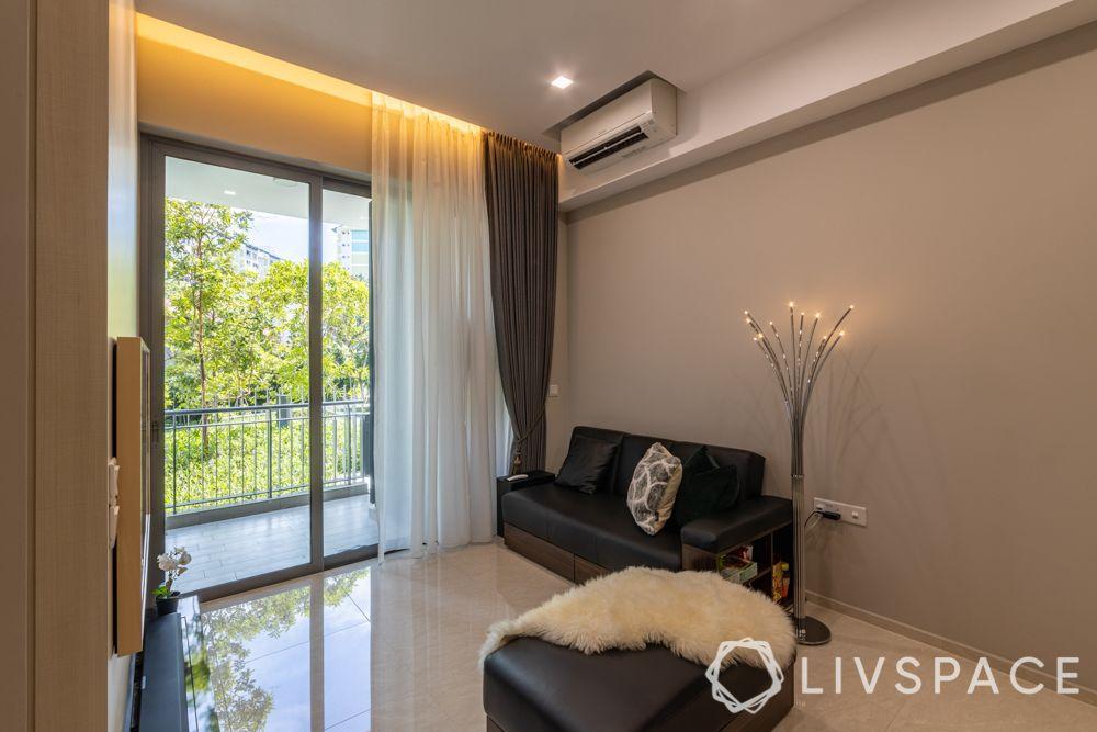 small-condo-renovation-ideas-living-room-storage-sofa-black-leather