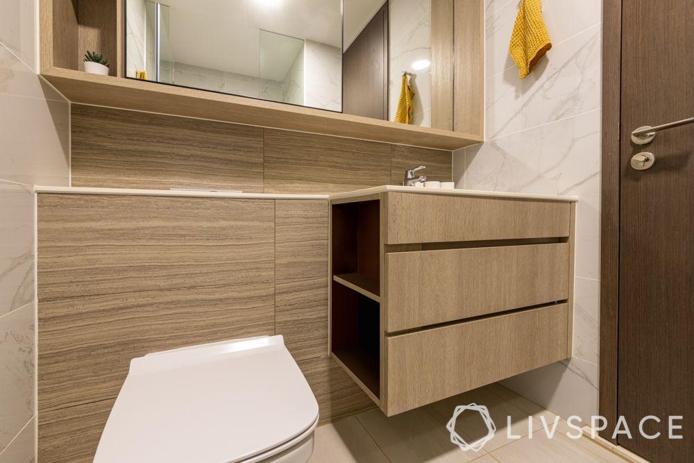 small-condo-renovation-ideas-toilet-wooden-vanity-storage-mirror