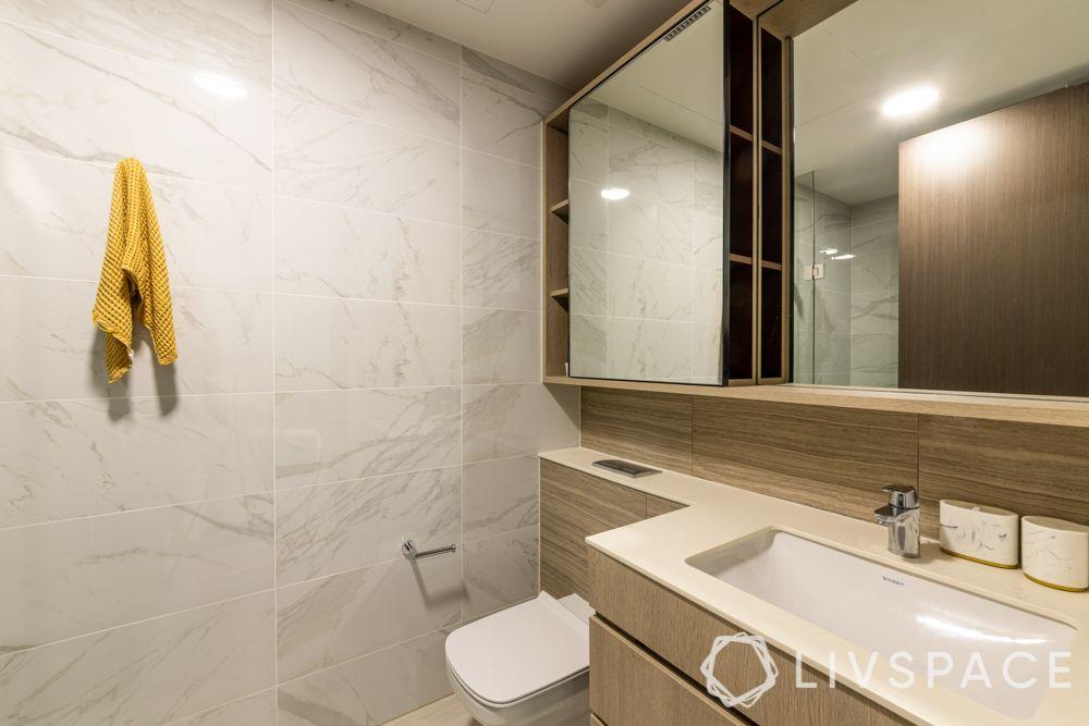 small-condo-renovation-ideas-toilet-white-tiles-vanity-storage-mirror