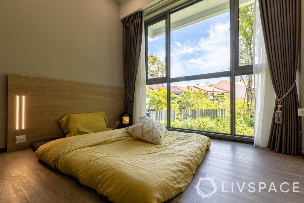 small-condo-renovation-ideas-bedroom-large-window-floor-bed