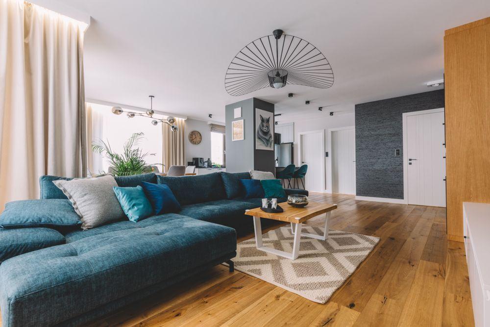hdb maisonette-blue velvet sofa-wooden flooring