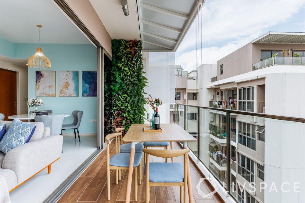 balconies-outdoor-seating-vertical-garden-wooden-table