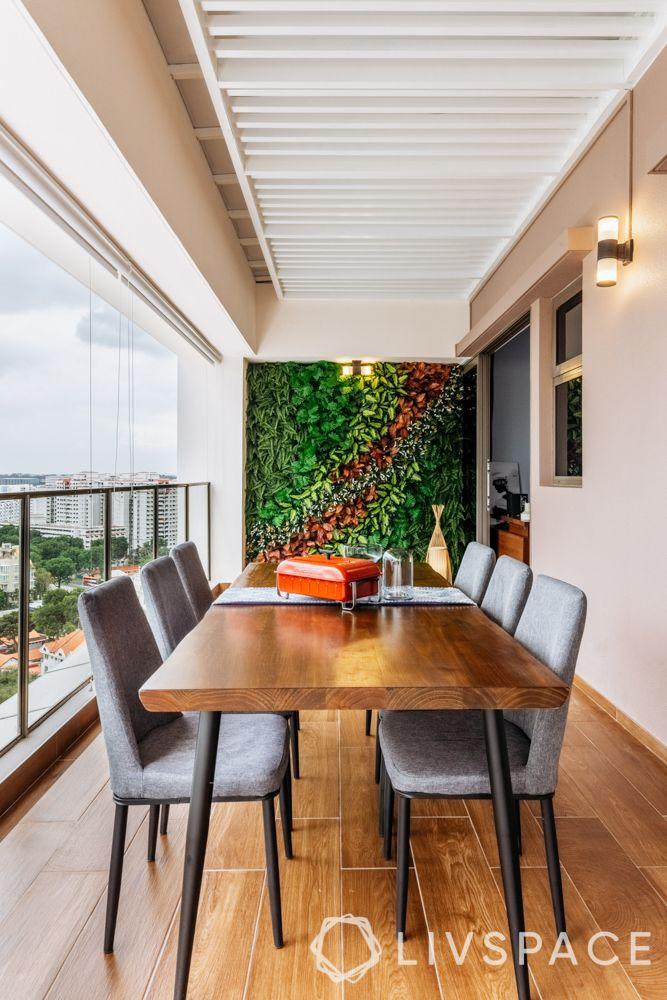balconies-wooden-flooring-wooden-table-vertical-garden-upholstered-chairs
