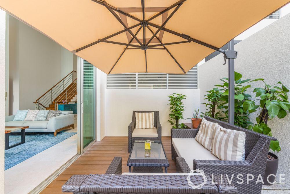 balconies-big-wooden-flooring-parasol-rattan-furniture