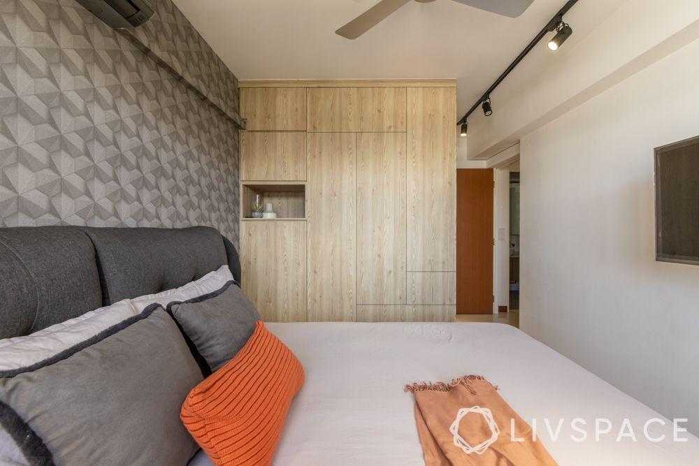 hdb-4-room-resale-renovationmaster-bedroom-wooden-wardrobe-grey-wallpaper-orange-grey-pillows