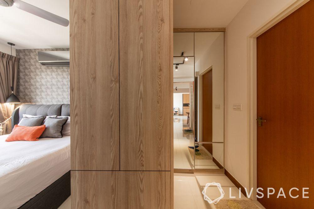hdb-4-room-resale-renovation-master-bedroom--wooden-wardrobe-mirror-panel