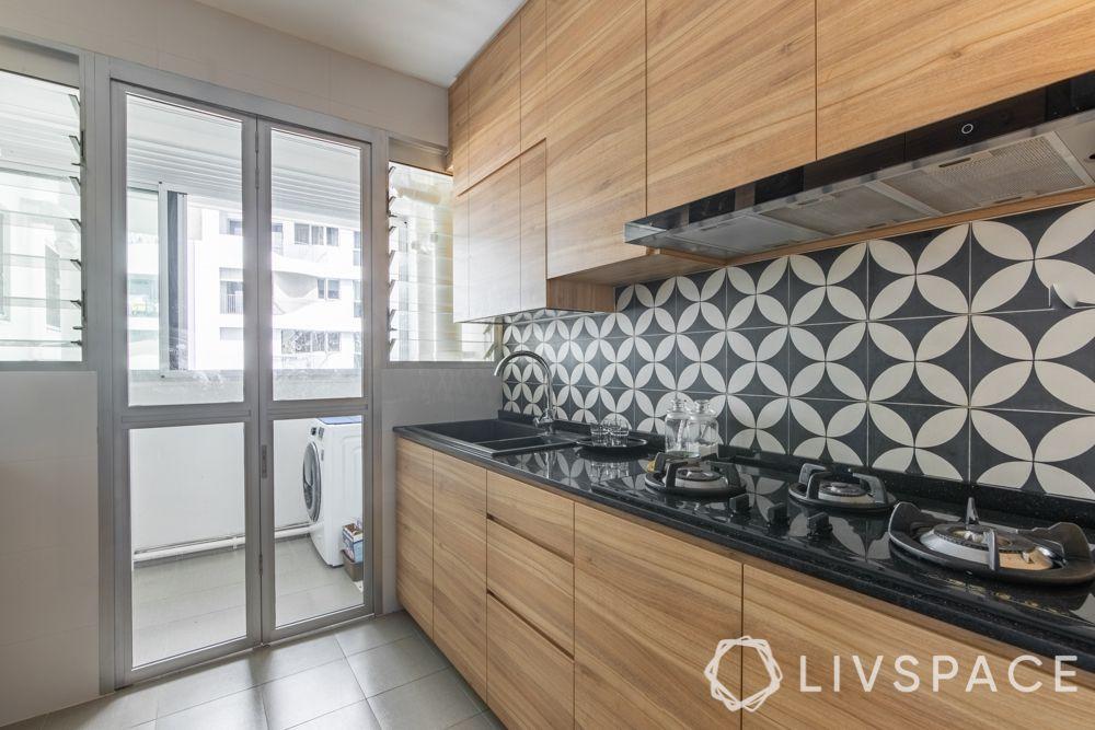 hdb-4-room-resale-renovation-kitchen-wooden-vertical-space-cabinets-hob-black-and-white-backsplash