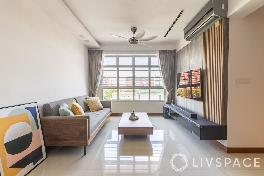 hdb-4-room-resale-renovation-living-room-grey-couch-black-tinted-glass-tv-unit