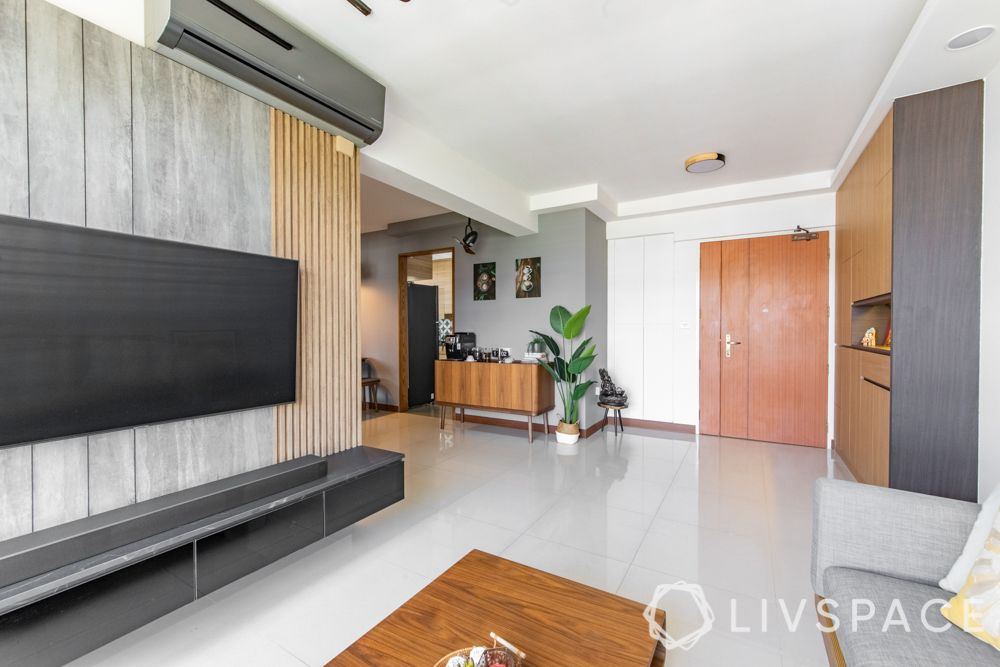 hdb-4-room-resale-renovation-living-room-tv-feature-wall-grey-wood-backpanel-black-glass-console