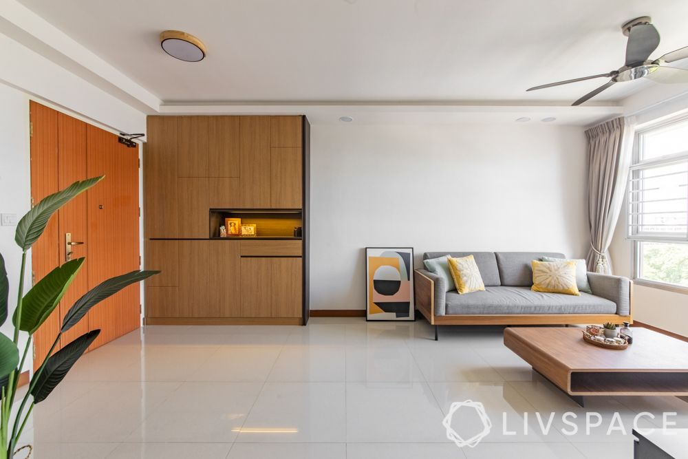 hdb-4-room-resale-renovation-entryway-wooden-unit-living-room-grey-couch-painting