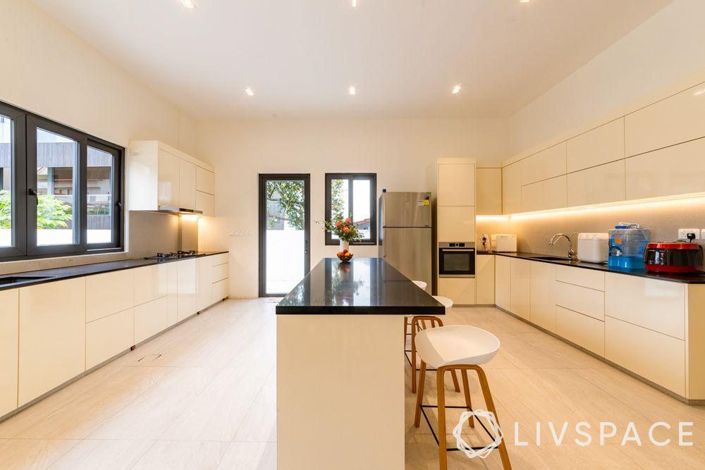 landed-house-design-big-kitchen-cream-cabinets-under-cabinet-lighting