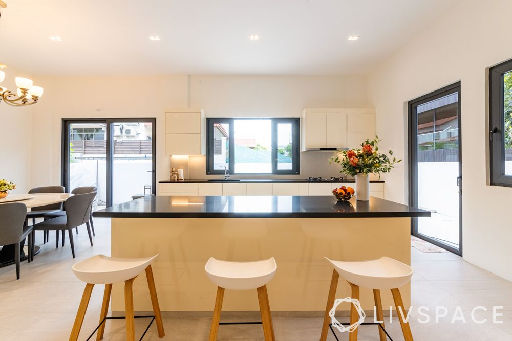 landed-house-design-kitchen-island-stools-black-countertop