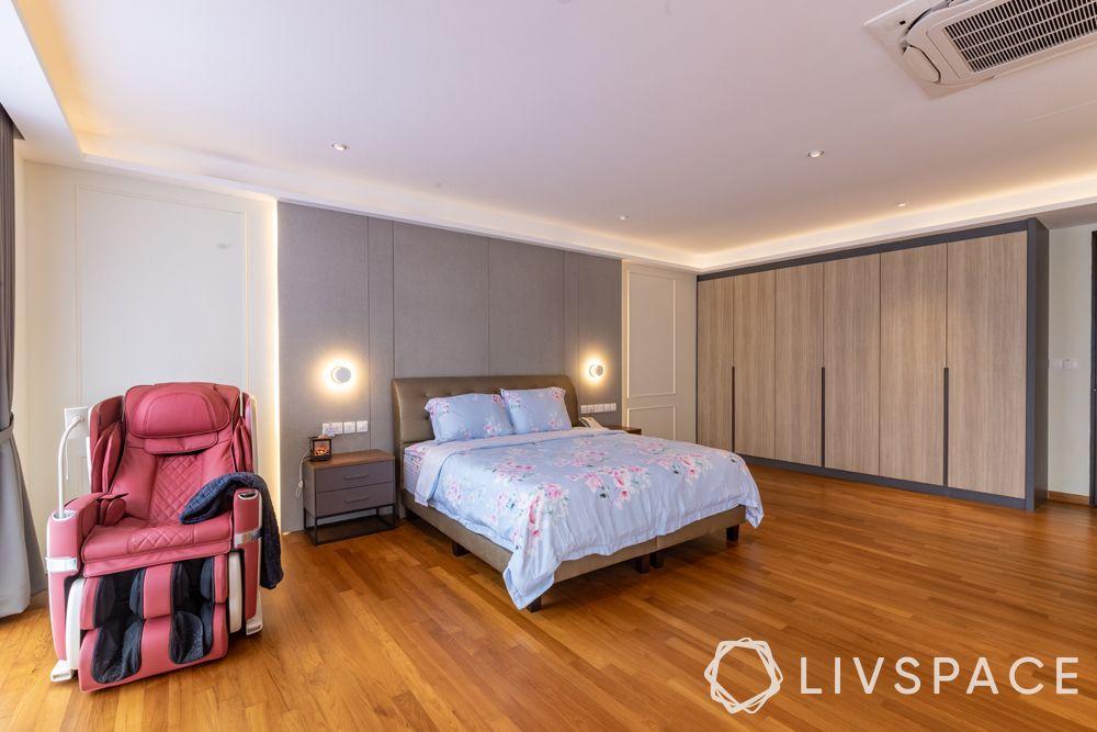landed-house-design-bedroom-red-recliner-wardrobes