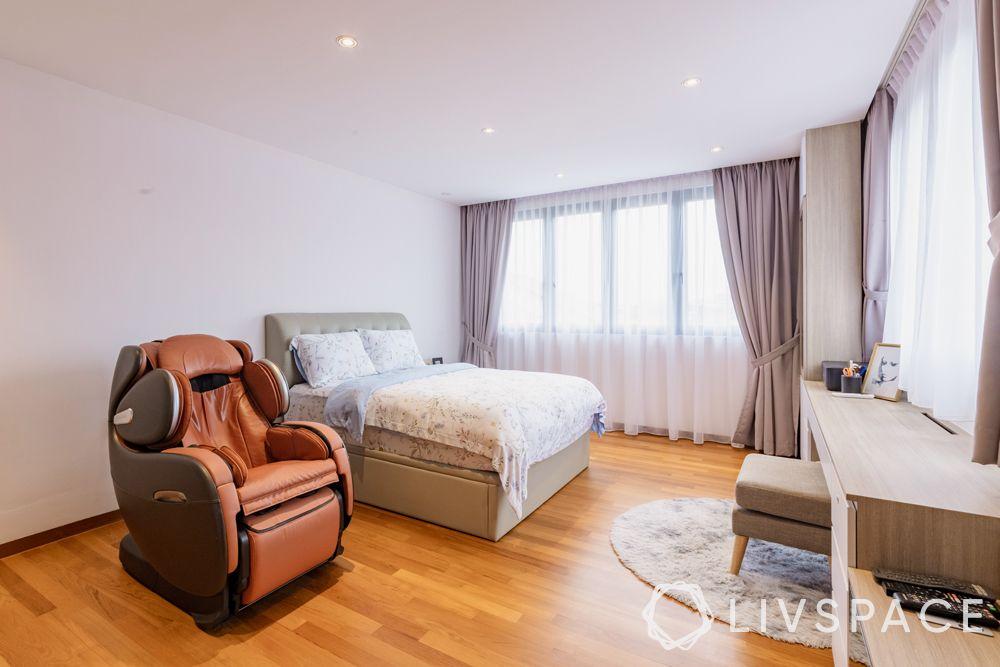landed-house-design-bedroom-wooden-flooring-recliner-upholstered-bed