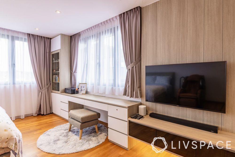 landed-house-design-bedroom-study-table-tv-unit-stool-drapes