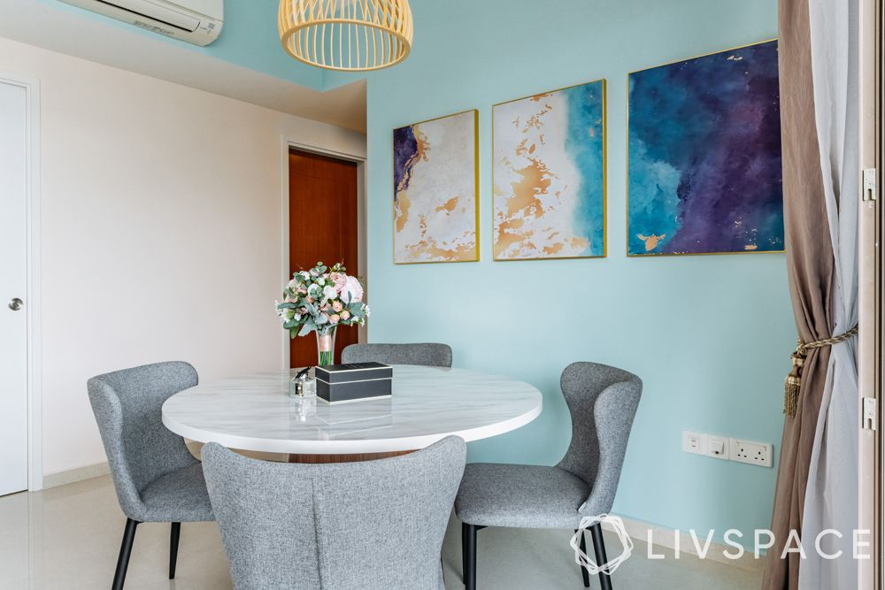 round-dining-tables-blue-wall-grey-chairs