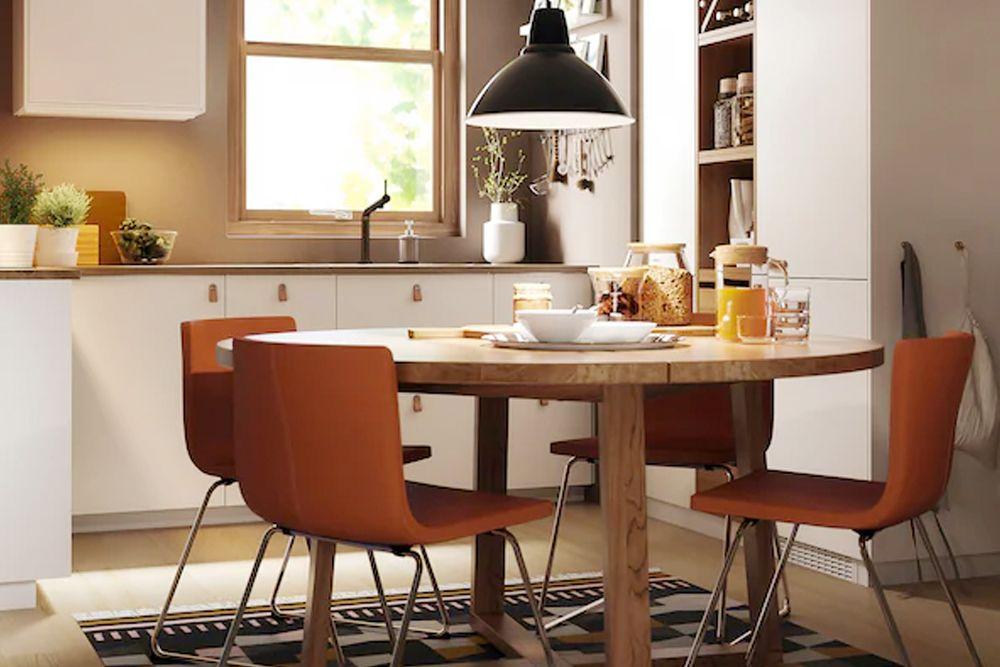 round-dining-tables-orange-chairs-kitchen