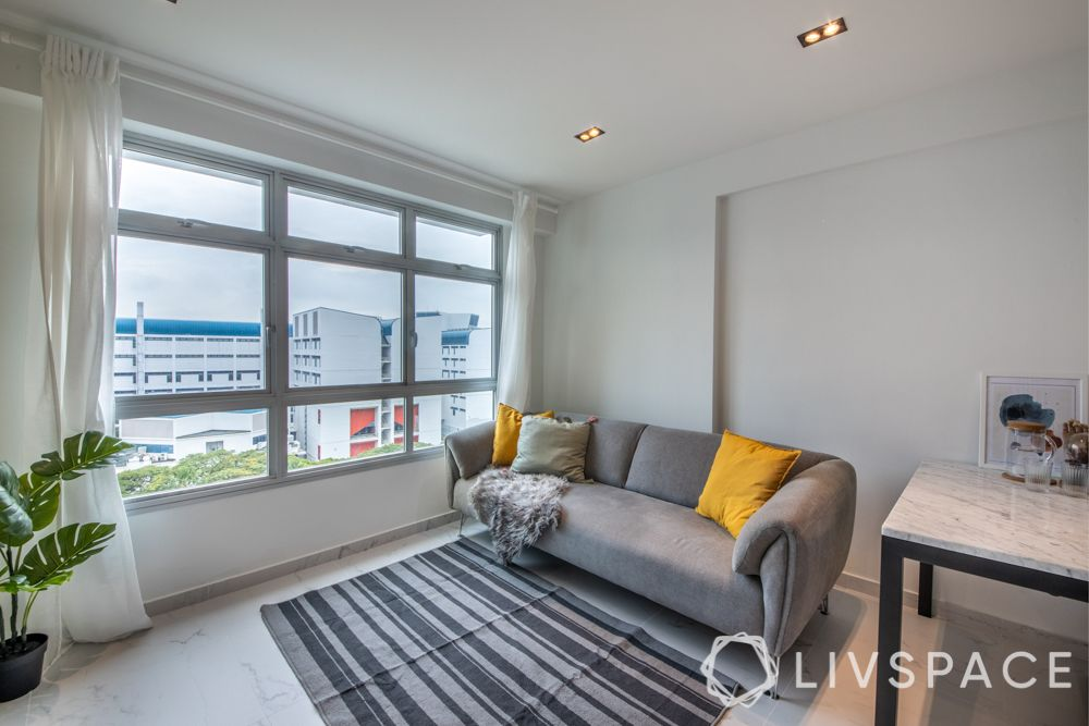 minimalist-living-room-rug-grey-throws