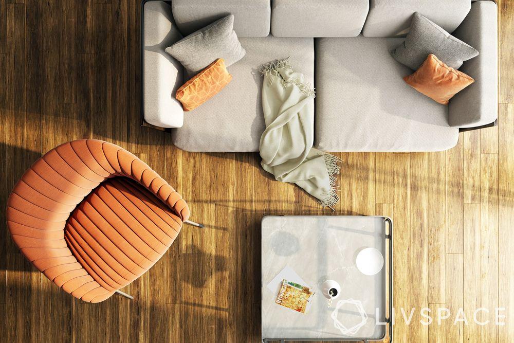 parquet-flooring–grey-sofa–square-table