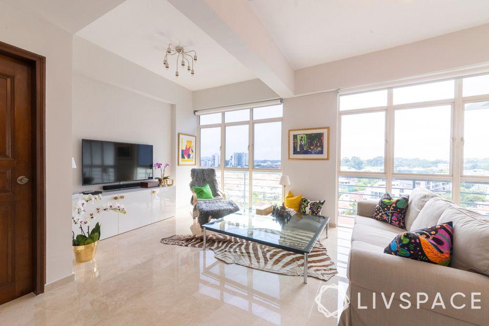 2-bedroom-condo-living-room-big-windows-glass-centre-table